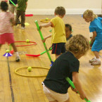 Sportball kids playing ball hockey in gym