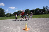 Children playing outdoor baseball.