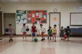 Children running to get basketball.