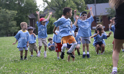 Sportball kids jumping for joy during Soccer class.